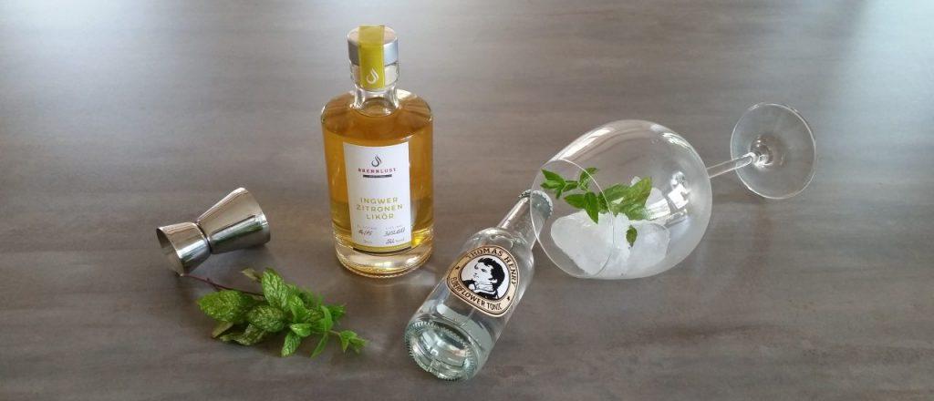 BRENNLUST | Ingwer Zitronen Likör mit Minze und Elderflower Tonic